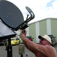Jim McKinney installing Internet Satellite Dish
