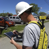 Staking Engineer Matt Love using GPS Locating System