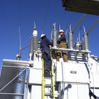 Linemen Josh Saier and Tom Westring work on Substation Transformer