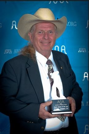 "Mike Day receiving ""Radio Station of the Year"" award from the Academy of Western Artists."