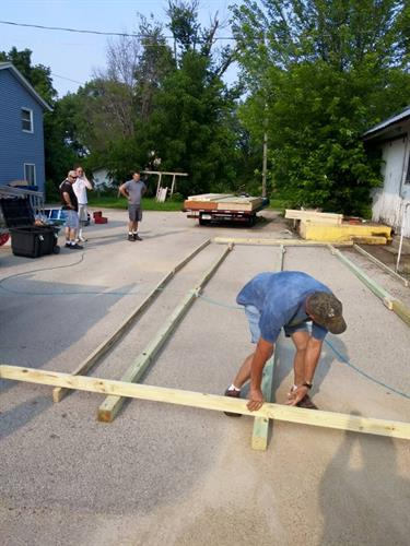 7/3/15 Corey at Clinton Custom Sheds begins onsite construction of Make it Yours Upcycle Center's retail store.
