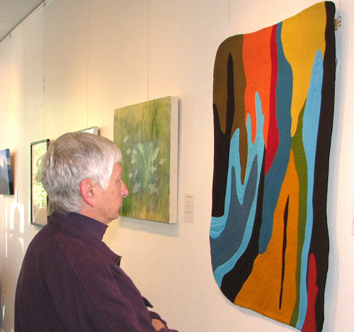 Guest enjoys viewing part of the Fiber Arts show.