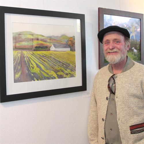 Tim Sullivan with his painting, Members Show.