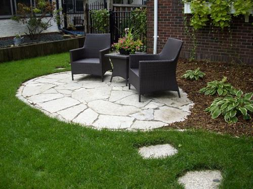 A flagstone patio and landscape installed by Barrett Lawn Care