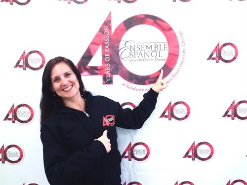 Leticia Aravena, Company Dancer and Teacher of the Ensemble Español Spanish Dance Theater posing with our new 40th Anniversary Hoodies!