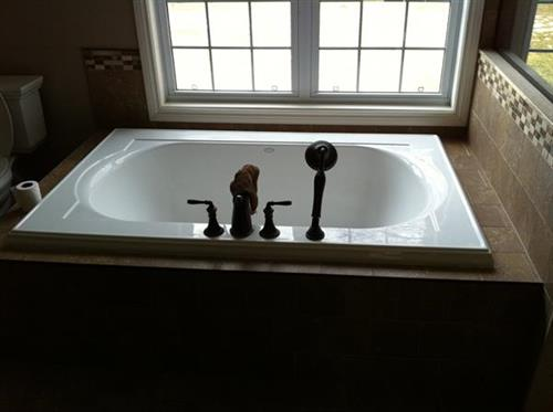 Soaker tub with Moen Roman Tub Tap