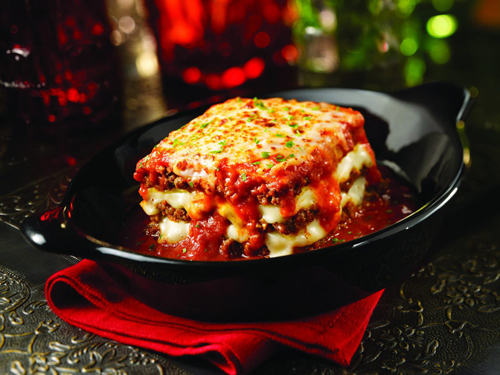 Baked Lasagna.  Layers of pasta filled w/ ground beef, ricotta cheese and topped with our signature pomodoro sauce and mozzarella cheese.