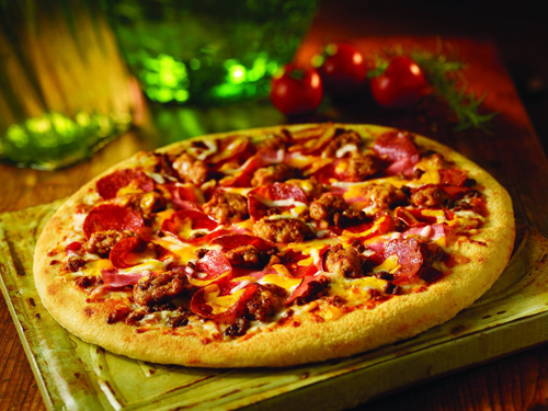 Mama Meata® Pizza.  Meat, meat and more meat! Bolognese sauce topped w/ smoked ham, pepperoni, ground beef and spicy Italian sausage covered w/ cheddar & mozzarella cheeses.