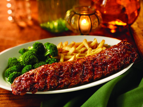 Baby Back Ribs. Mmmmm.  Tender, lean and slow-roasted to perfection, smothered w/ Sweet Baby Ray's Barbecue Sauce® and served w/ your choice of two sides!