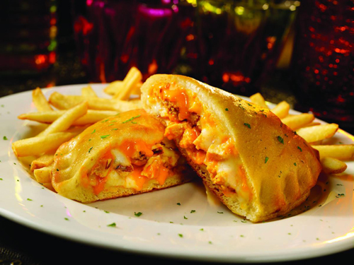 Buffalo Chicken Calzone.  Spicy chicken w/ Parmesan bread crumbs, fontina & mozzarella cheeses topped in our Creamy Buffalo wing sauce, folded inside our handcrafted pizza dough and baked until golden brown.