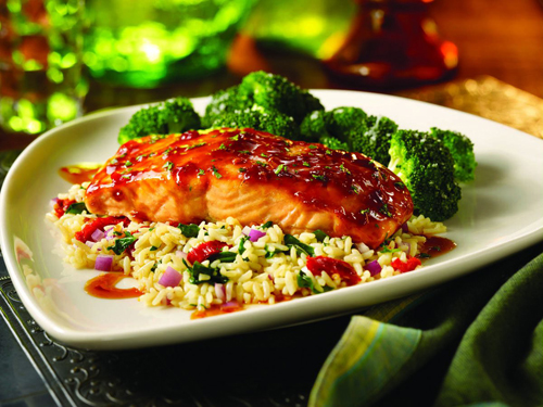 Asian-Glazed Salmon.  An 8oz. salmon filet topped w/ our Asian glaze and served w/ broccoli and Florentine rice.