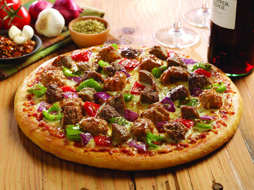 Double Meat and Peppers Pizza.  Sausage and meatballs piled atop our famous pizza sauce w/ fresh roasted red onions, red & green peppers and mozzarella cheese.