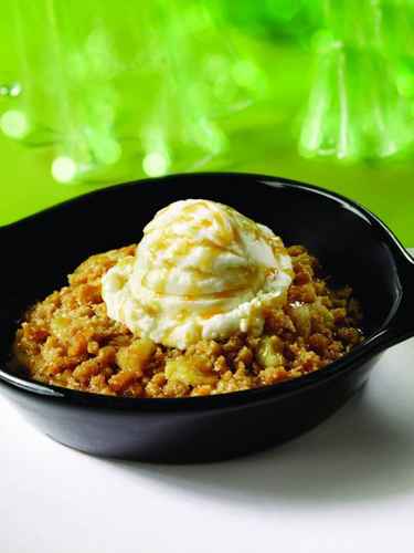 Apple Crisp.  The perfect blend of Granny Smith apples, brown sugar and cinnamon crumbles baked until golden brown. Topped w/ vanilla ice cream and drizzled w/ brandy butter sauce!