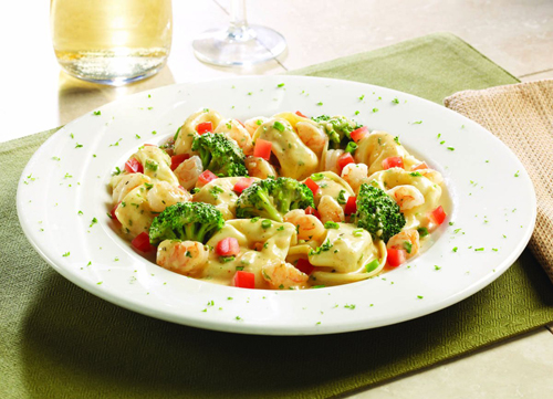 Shrimp Tortelloni  Cheese tortelloni and sauteed shrimp with broccoli, green onions and tomatoes tossed in garlic butter and a rosemary-chipotle sauce.