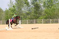 Student getting lesson in outdoor arena