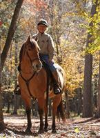 Ranch weekend guest riding the trails