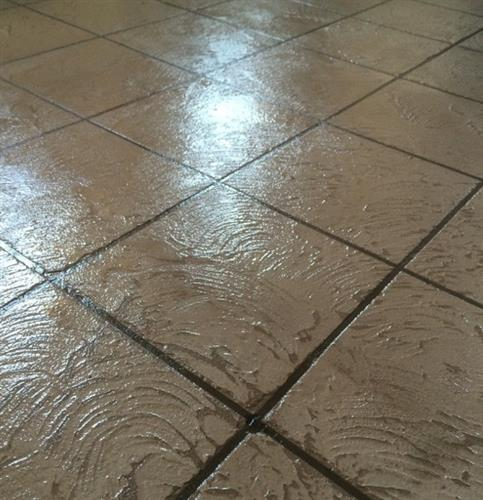 Tile pattern with the color integrated into the overlay.  It's finished with a clear coat sealant.
