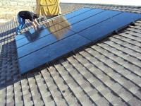 SunPower solar panels installed on a pitched roof with asphalt shingles