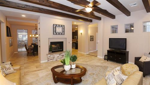 A warm, comfortable living area with double-sided fireplace is featured in our Azusa and Del Mar floor plans