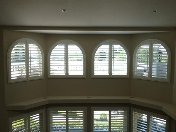 Custom Budget Blinds Hampton wood shutters with power tilt for high windows