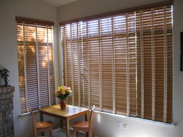 Faux wood blinds with decorative tape