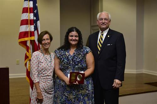 Enrollment Coordinator, Summer Davis, receiving the Virgil Parks McKinley Employee Award. Summer was recognized for her outstanding work as a TROY non-faculty professional. (L-R: Site Director, Lynn Chapman; Summer Davis; TROY Chancellor Dr. Jack Hawkins