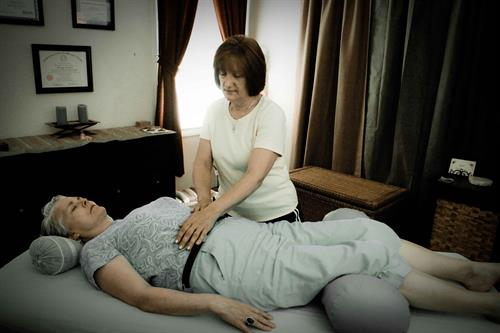 Reiki is performed with the client fully clothed lying on a massage table or sitting in a chair.