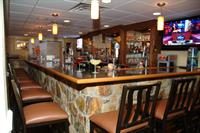 The Grill House & Pub offers craft brews, delicious food, and a casual atmosphere with 7 flat screen TV's.  Outside seating is available on The PAR-TEE Deck overlooking the beautiful course.