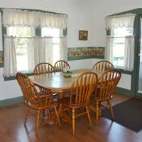 A handsome maple dining table in Cottage E
