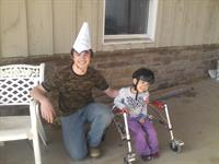 Volunteer Michael Tellup wearing his Birthday Hat designed by Westly Strom during Wesley's lesson