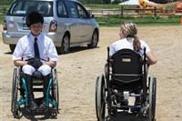 Ray Popick and Mary Husty chatting before mounting their horses at the MCET Games