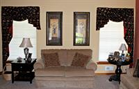 Asymmetrical Swags enhance this room in Floral Embroidered Fabric with contrast to match the side wall.