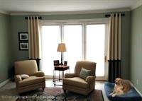 Colorblock? Stationary Grommet Panels on Short Decorative Rods bring an Elegance to this room your friends and dog will love!