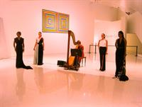 Harpist Esther Underhay performs for Couture Preview by Marcello Vittoria at Museum of Art in Fort Lauderdale