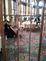 The Elegant Harp in The Incomparable Breakers Circle Room