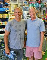 Rick and Kelly Slater chilling at the shop