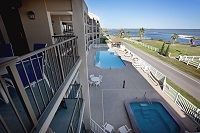 Balcony view of pool and bay.