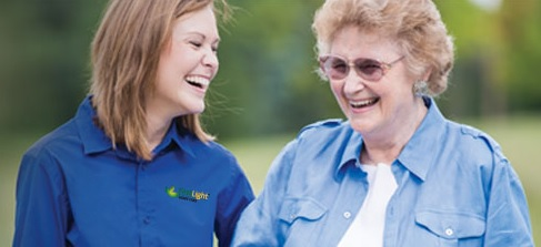 FirstLight HomeCare caregiver and client.