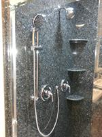 Shower with granite slab on walls