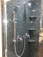 Shower with granite slab on walls
