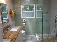 This is a custom bath electronic 4 zone shower control heated floors customer glass enclose and much more