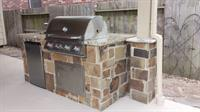 Outdoor kitchen and stone wrapped post