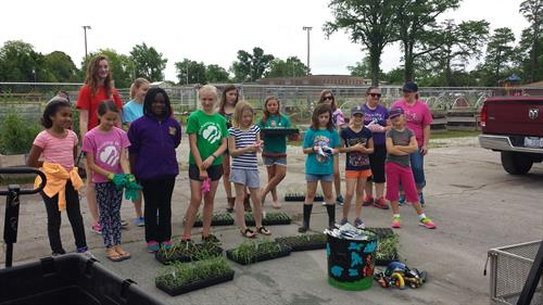 Girl Scouts planting at the garden