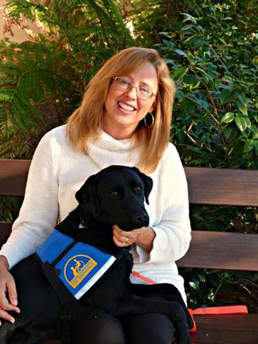 A Hearing Alert dog from CCI served by KIM services
