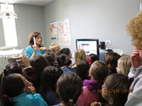 Demonstrating the intra-oral camera to a school field trip group