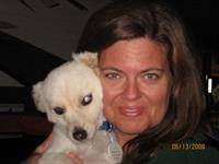 Lori Mikesell, owner of THE CRAZY DOG LADIES, with her own dog, Dinky.