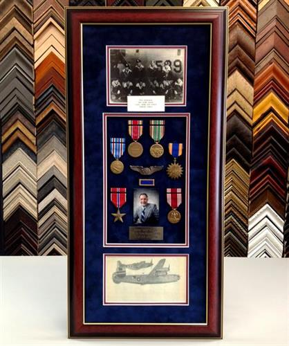 Framed WWII medals and photos.