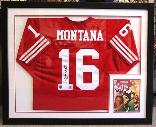 Framed Joe Montana jersey with inset photo.