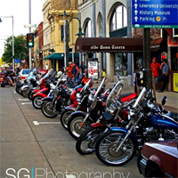 Motorcycles find a great parking spot for the Heid Music Summer Concerts.