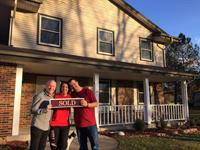 Steve & Julie with Kevin in front of their new home in Cedarburg!